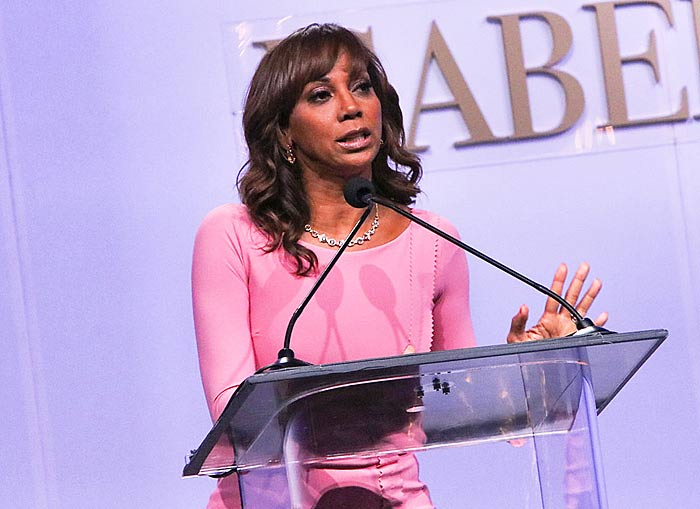 Holly Robinson-Peete at the podium speaking